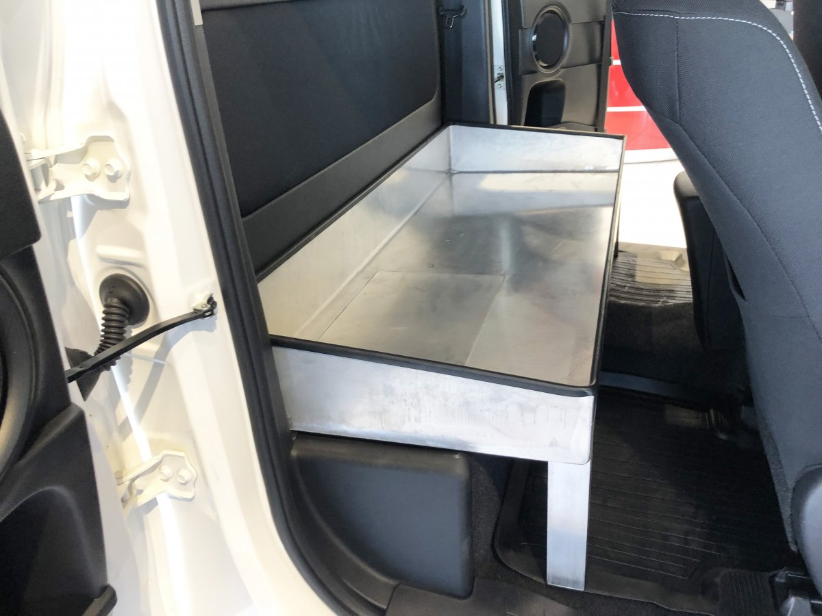 New option : an open aluminum tray fitted in the rear part of the cabin and accessible through the side doors